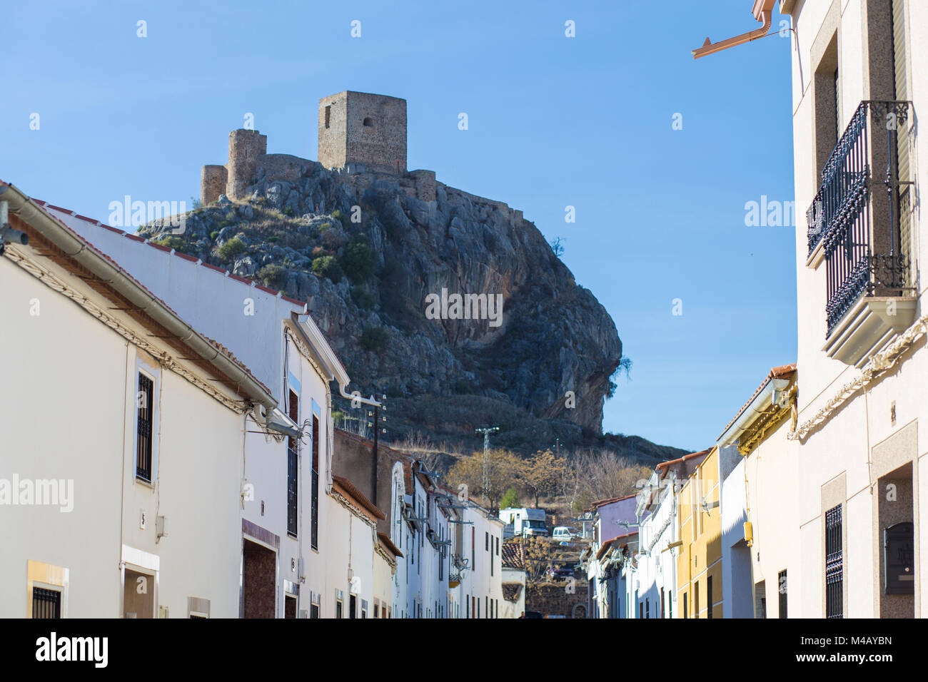 Outcrop rocky hill with Castle of Belmez, Cordoba, Spain. View from town streets - Stock Image