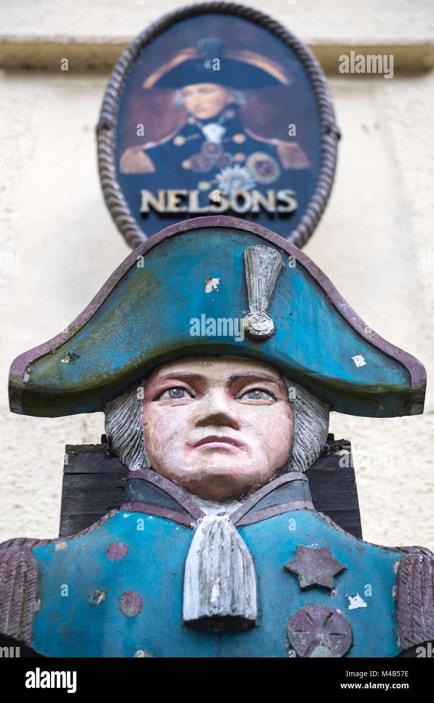Figure of Nelson outside a pub in Polperro, Cornwall, England, UK - Stock Image