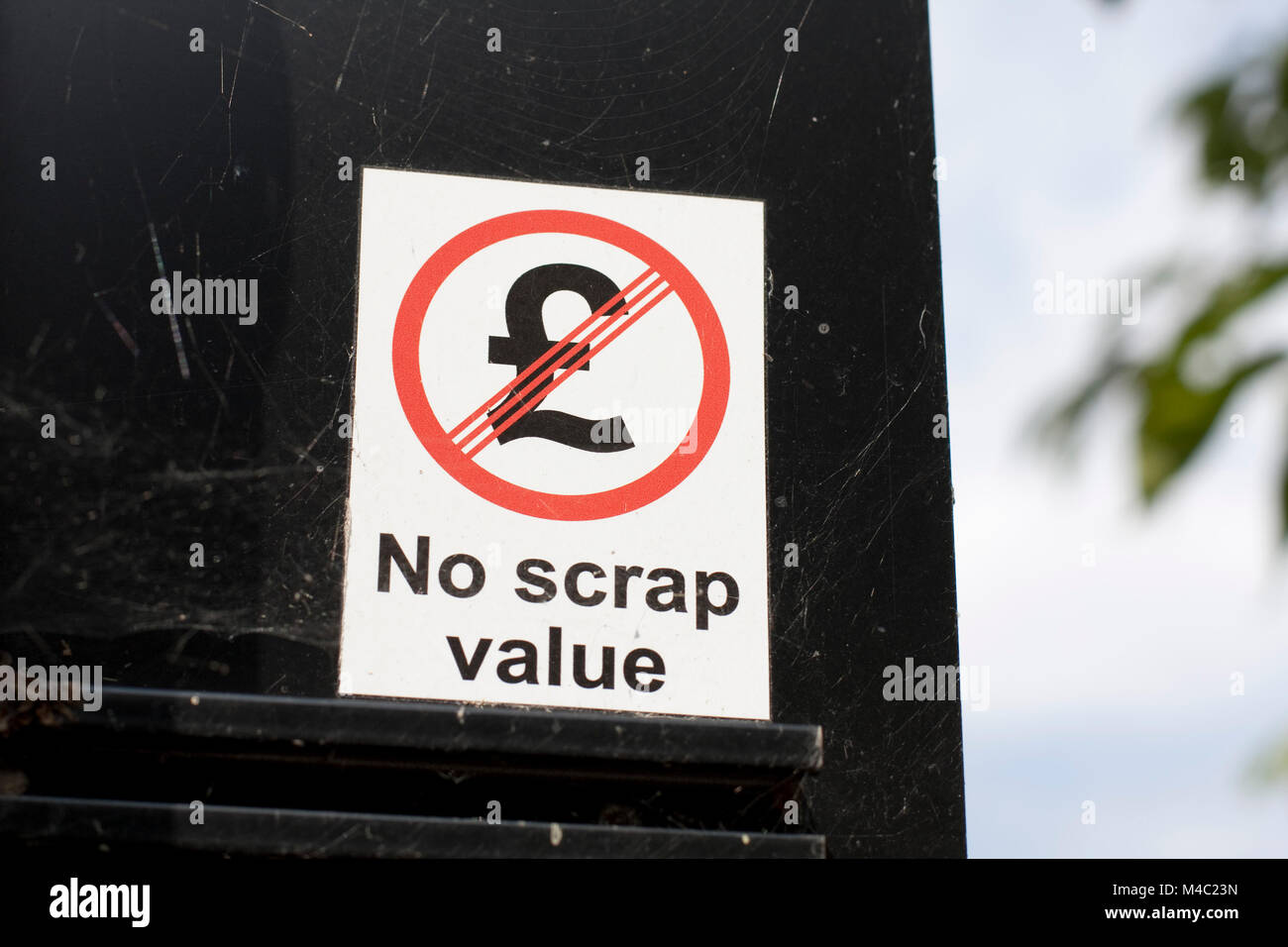 'No scrap value' notices on the back of road signs in Hackney - Stock Image