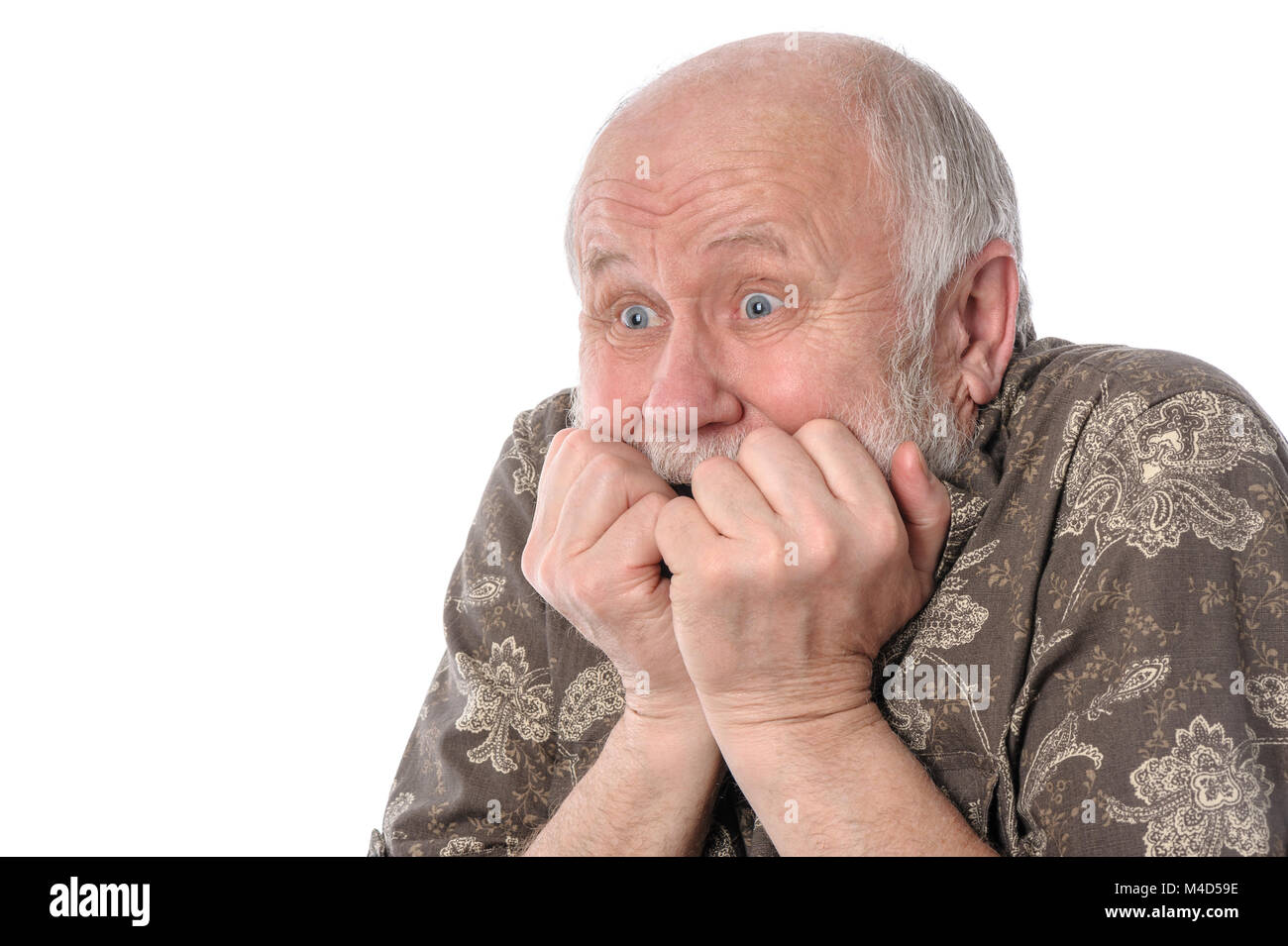 Senior man with grimace of fear, isolated on white - Stock Image