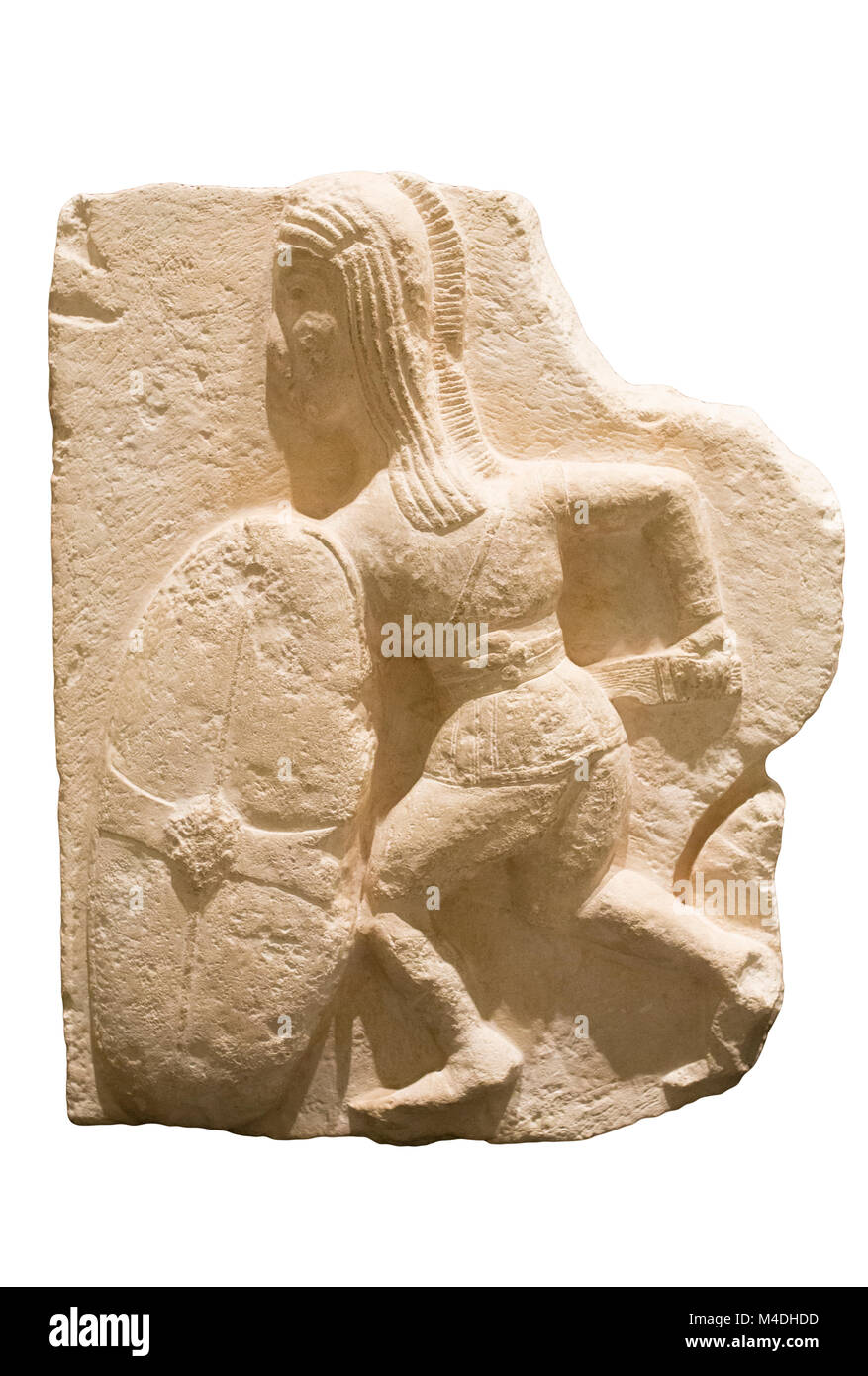 Madrid, Spain - November 10, 2017: Young Iberian warrior carrying a scutum or shield. High relief belong to Osuna - Stock Image