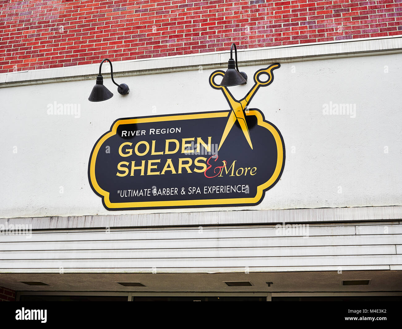 Hair salon or stylist shop sign above the front entrance to the storefront in downtown Montgomery Alabama, USA. - Stock Image