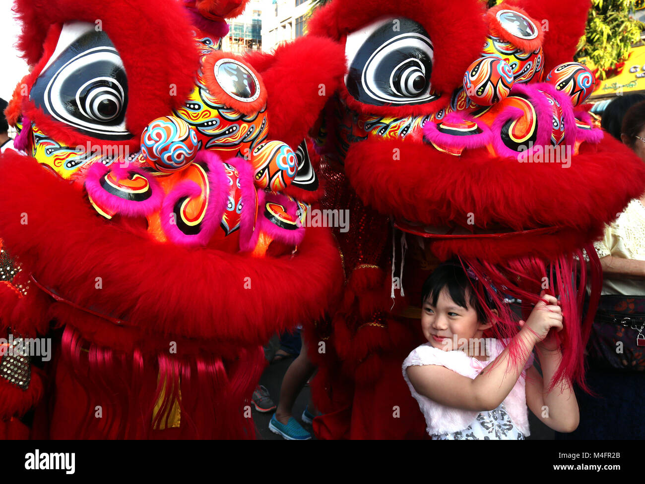 Yangon, Myanmar. 16th Feb, 2018. A girl plays during the Chinese Lunar New Year celebration in the Chinatown of - Stock Image