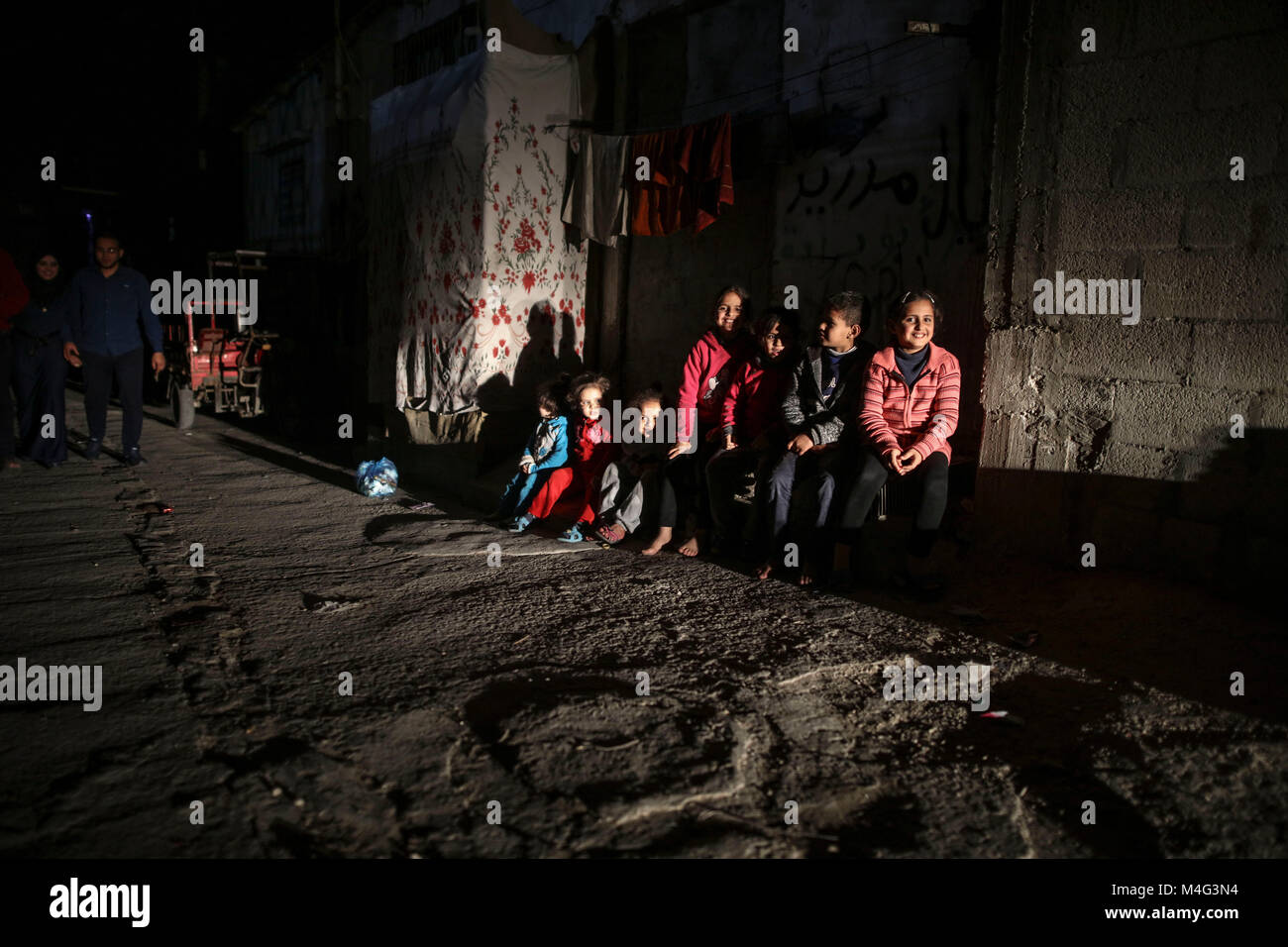 Gaza City, Palestinian Territories. 15th Feb, 2018. Palestinian children play in a dark street during apower outage - Stock Image