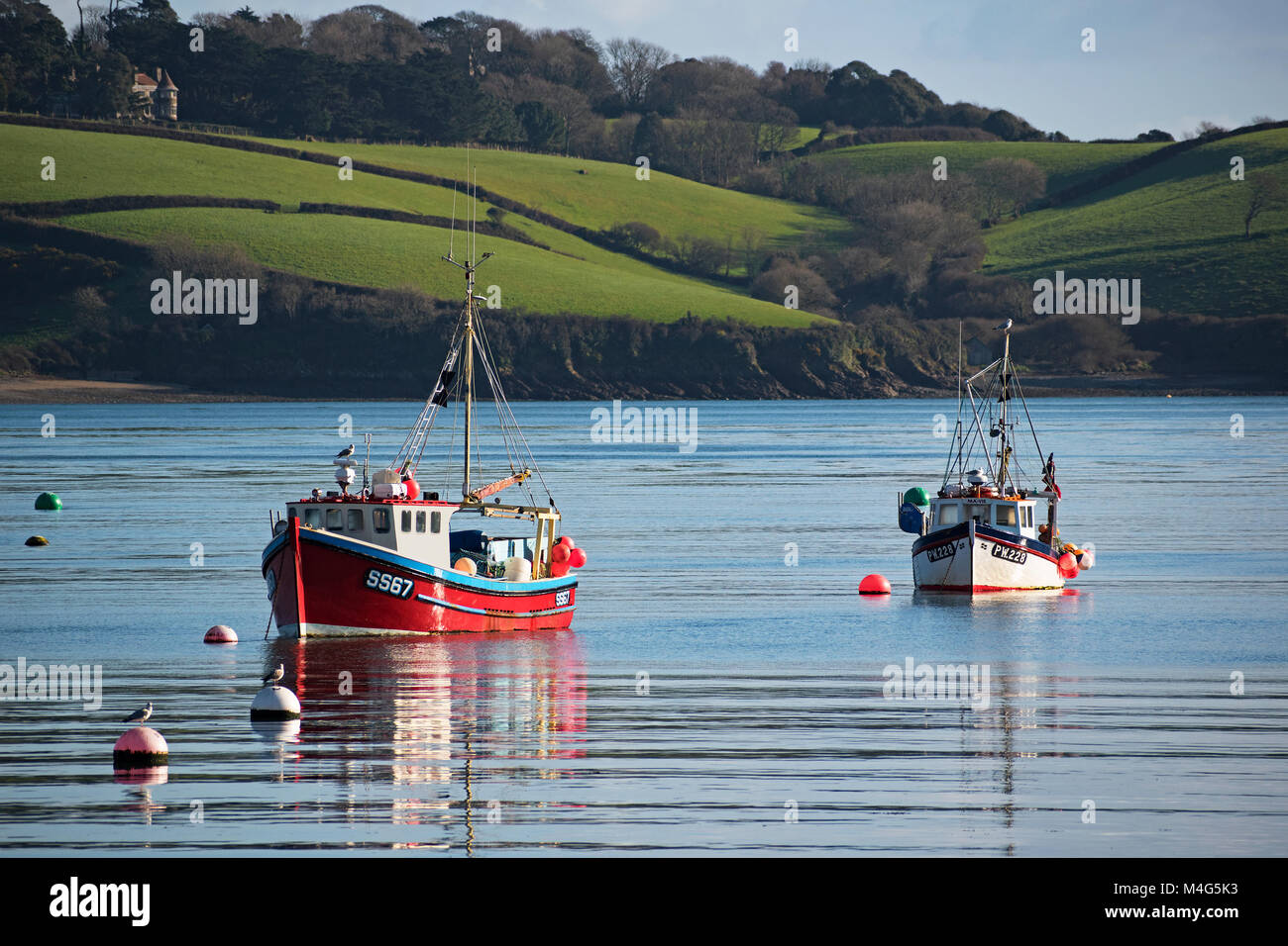 Helford river, Cornwall, UK. 16th Feb 2018. A lovely calm amd sunny day for the Cornish fishing boats on the Helford - Stock Image