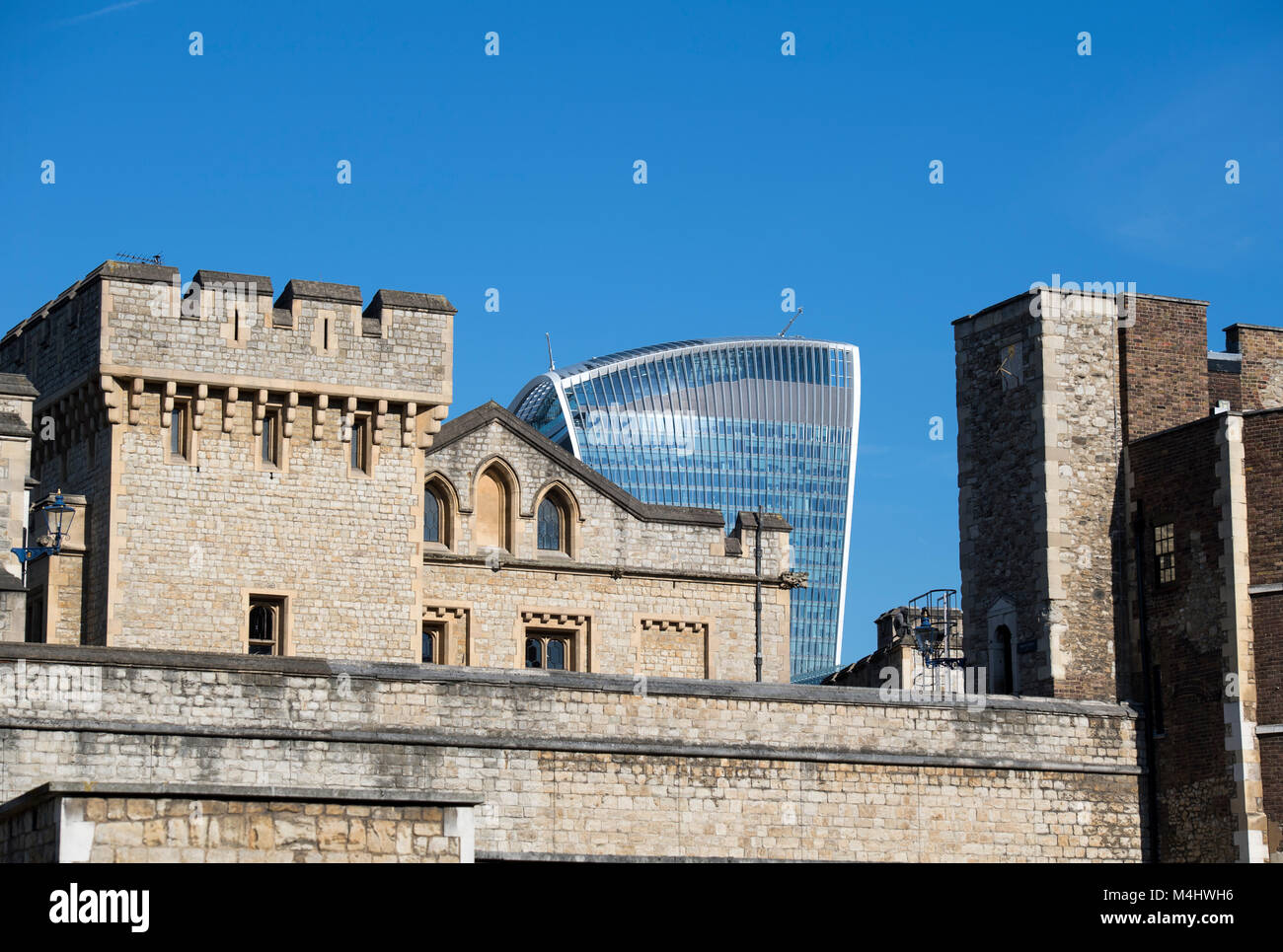 Walls of the Tower of London with the Walkie Talkie building in the background, London, England UK - Stock Image