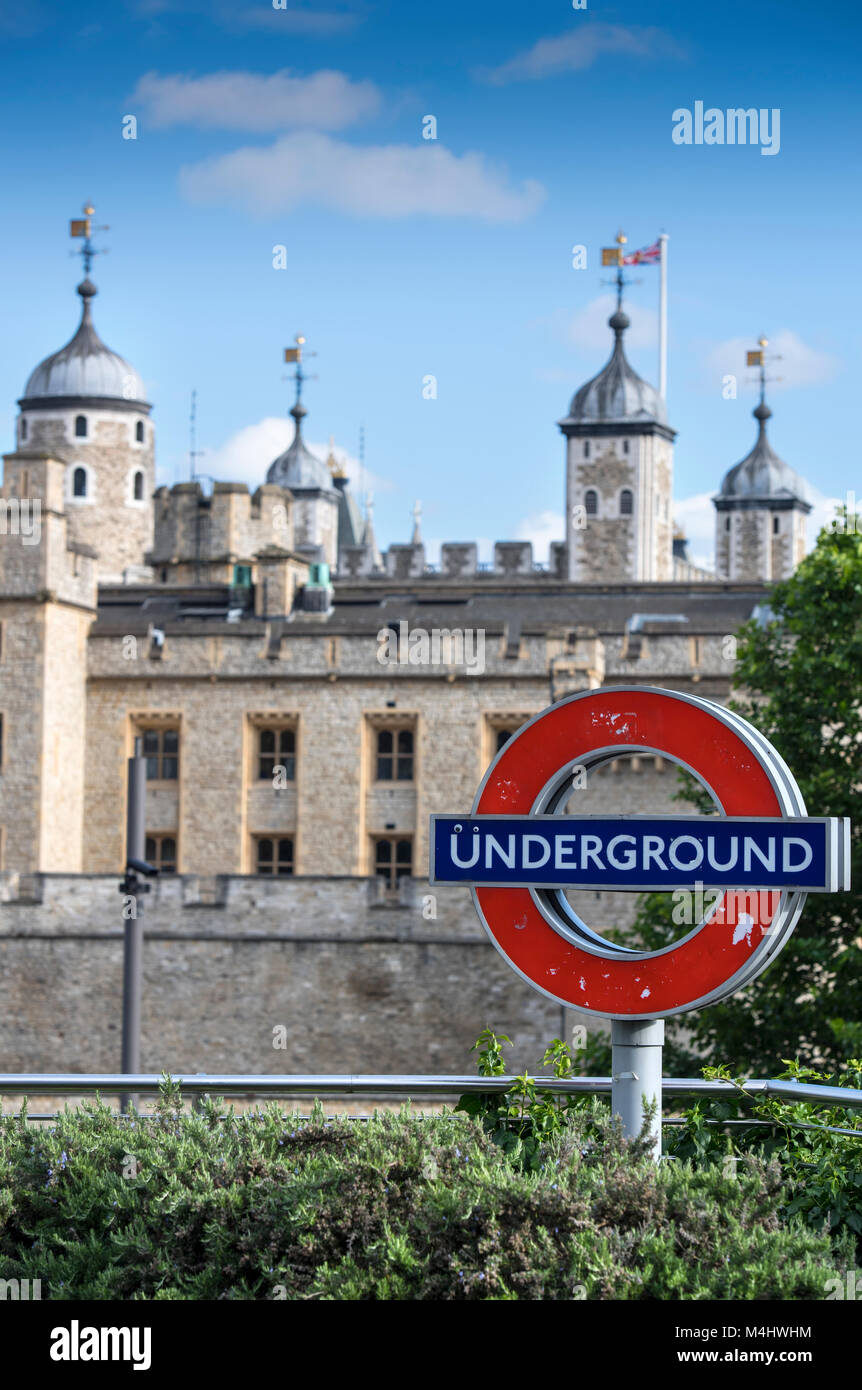 The Tower of London, with a London underground sign in the foreground, England, UK - Stock Image