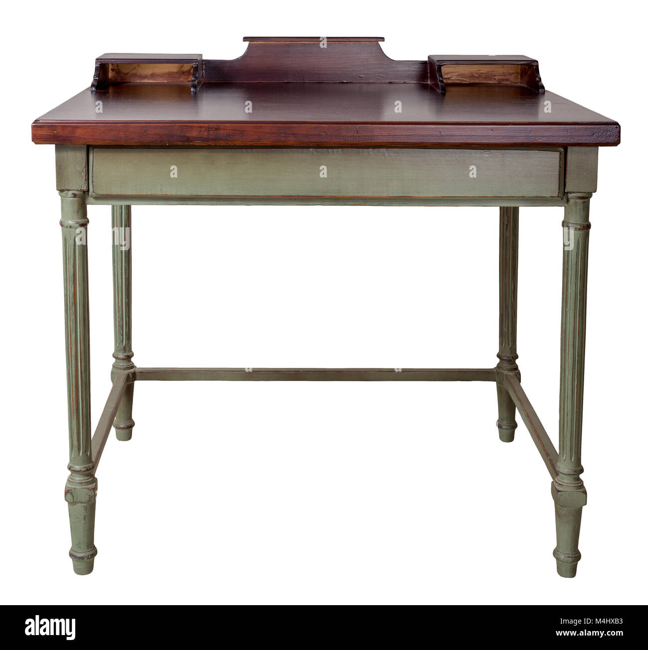 Vintage Furniture - Retro wooden desk table with two built-in trays, dark brown top and light green legs isolated - Stock Image