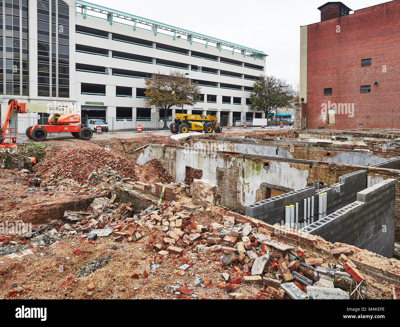 Demolition of an old brick building for remodeling in an urban redevelopment project in downtown Montgomery, Alabama - Stock Image