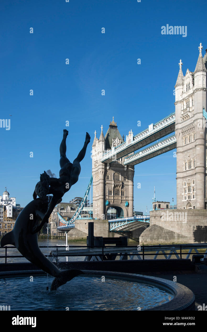Girl With a Dolphin statue created by artist David Wynne near Tower Bridge in London, England, UK - Stock Image