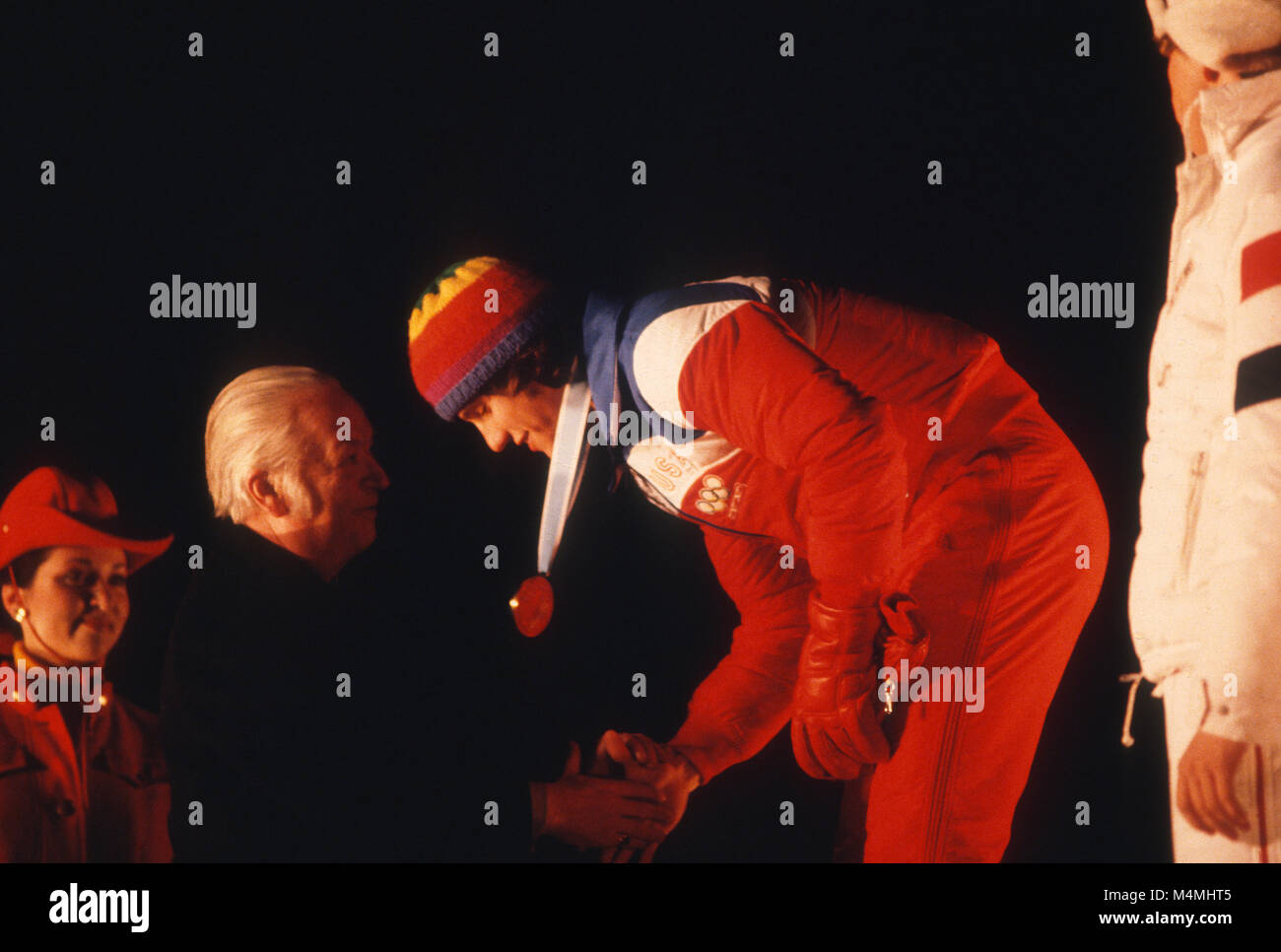 Eric Heiden receiving one of  his five gold medals in speedskating from then IOC President, Lord Killanin at the - Stock Image