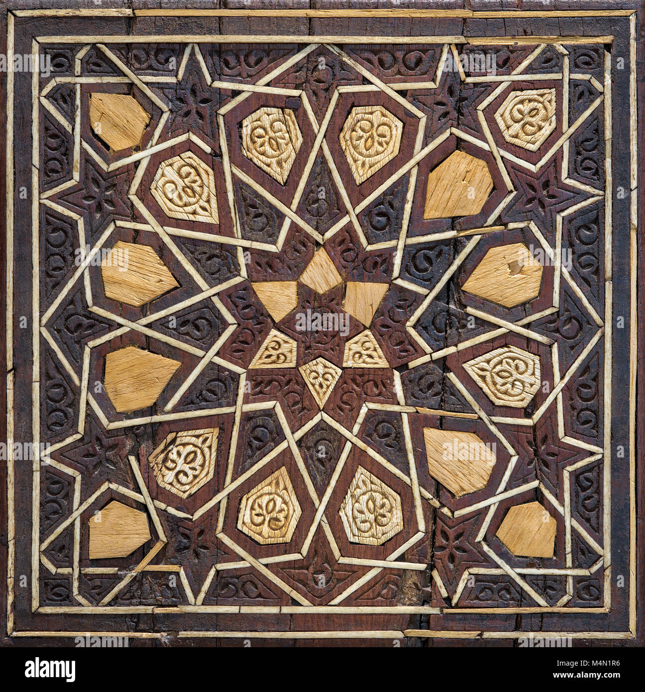 Closeup of arabesque seamless geometric pattern on an ancient wooden pulpit (Minbar) brought from the mosque of - Stock Image