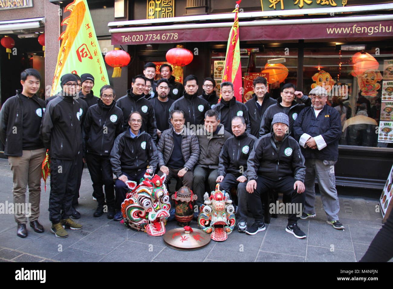 London, UK. 17th Feb, 2018. Members of a Chinese Organisation pose for photos in China Town London on 17 February - Stock Image