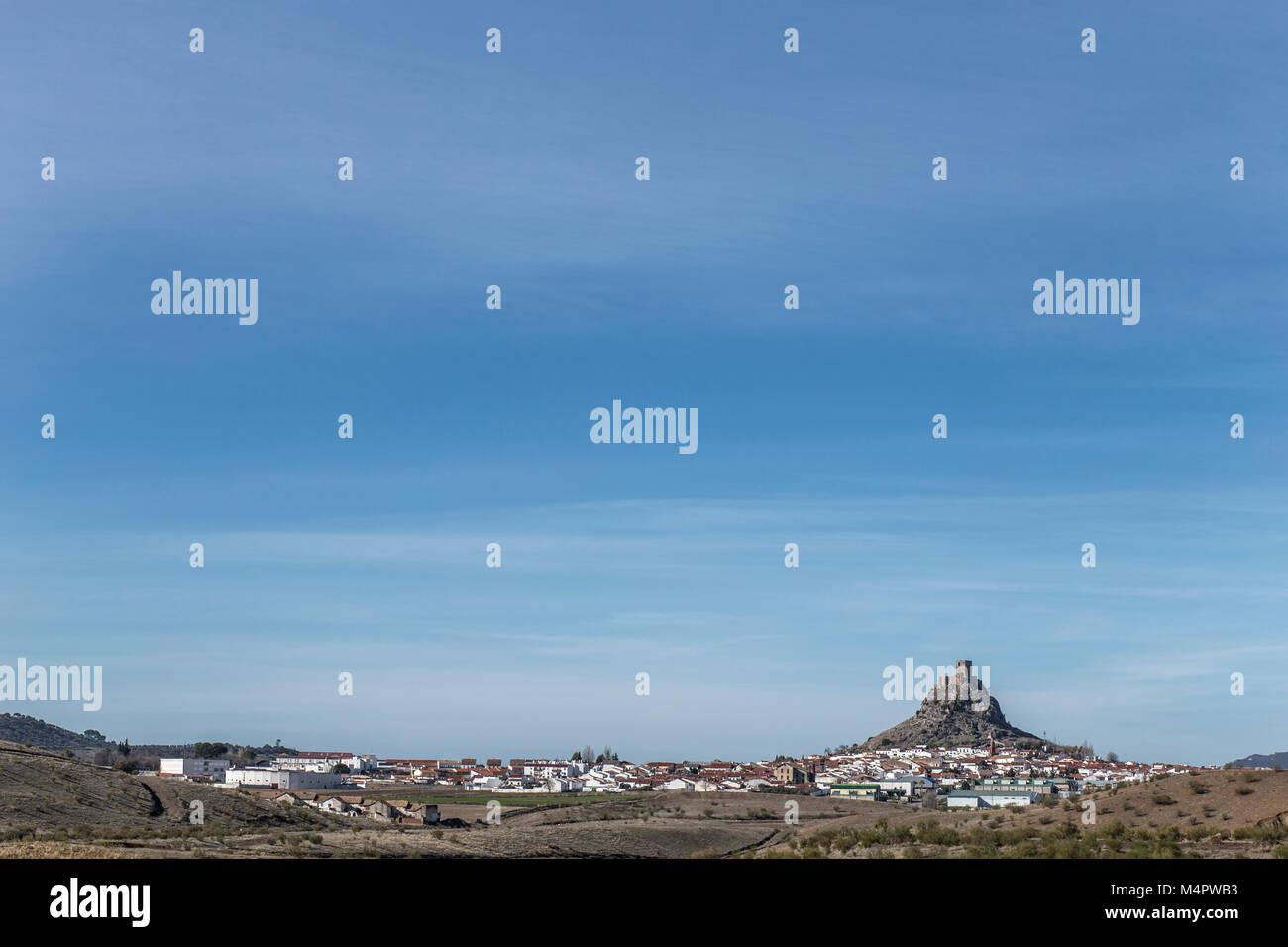 Outcrop rocky hill with Castle, Cordoba, Spain. Situated on the high rocky hill overlooking town of Belmez - Stock Image