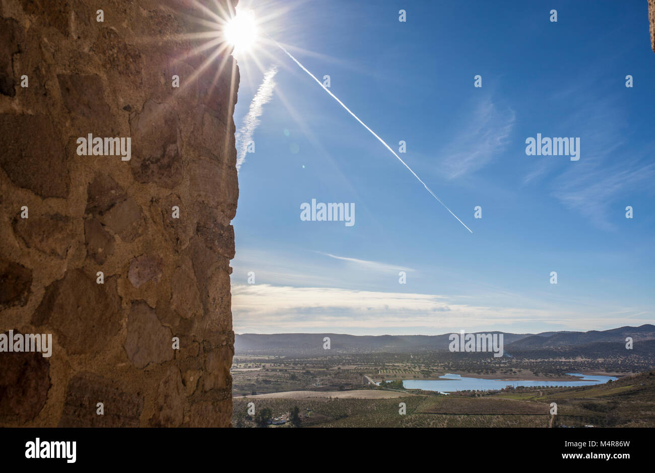 View from Castle of Belmez tower with jet contrail and sunshine, Cordoba, Spain. Situated on the high rocky hill - Stock Image