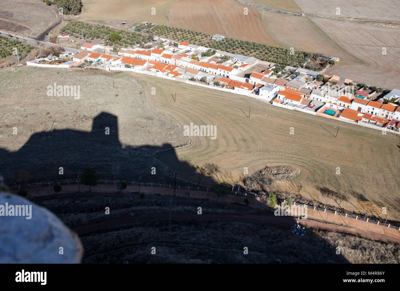 Castle of Belmez shadow getting close to town, Cordoba, Spain. Situated on the high rocky hill overlooking town - Stock Image