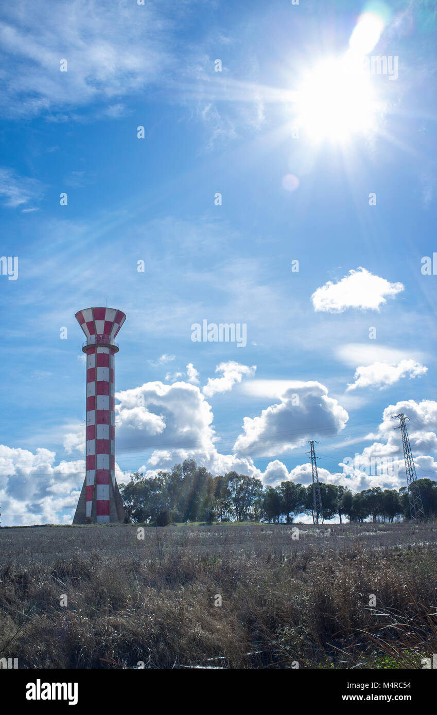 Irrigation water tank over blue sky. Concrete tower made for store irrigation water, Vegas Bajas del Guadiana, Extremadurs, - Stock Image