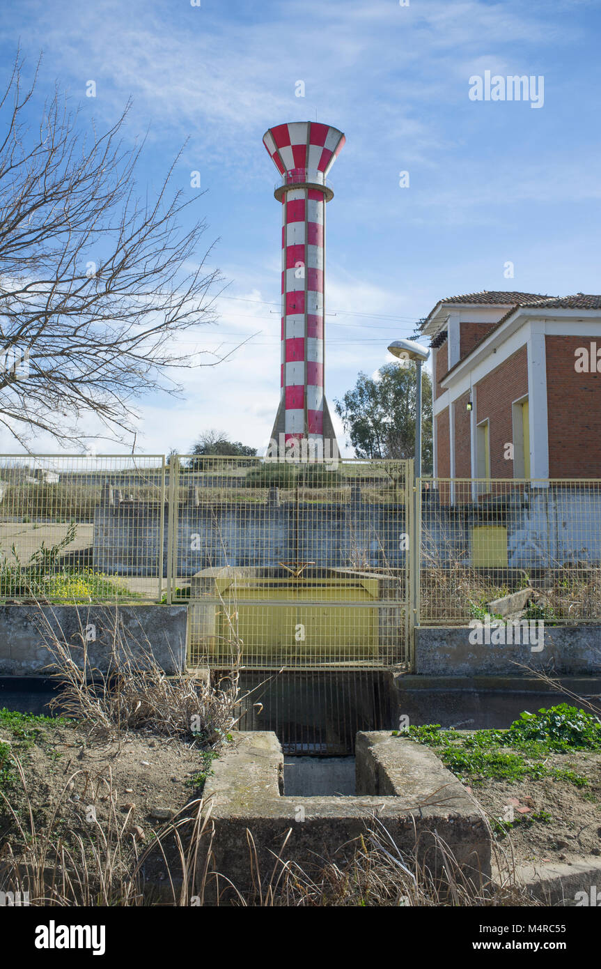 Irrigation water tank over blue sky. Concrete tower made for store irrigation water, Vegas Bajas del Guadiana, Extremadura, - Stock Image