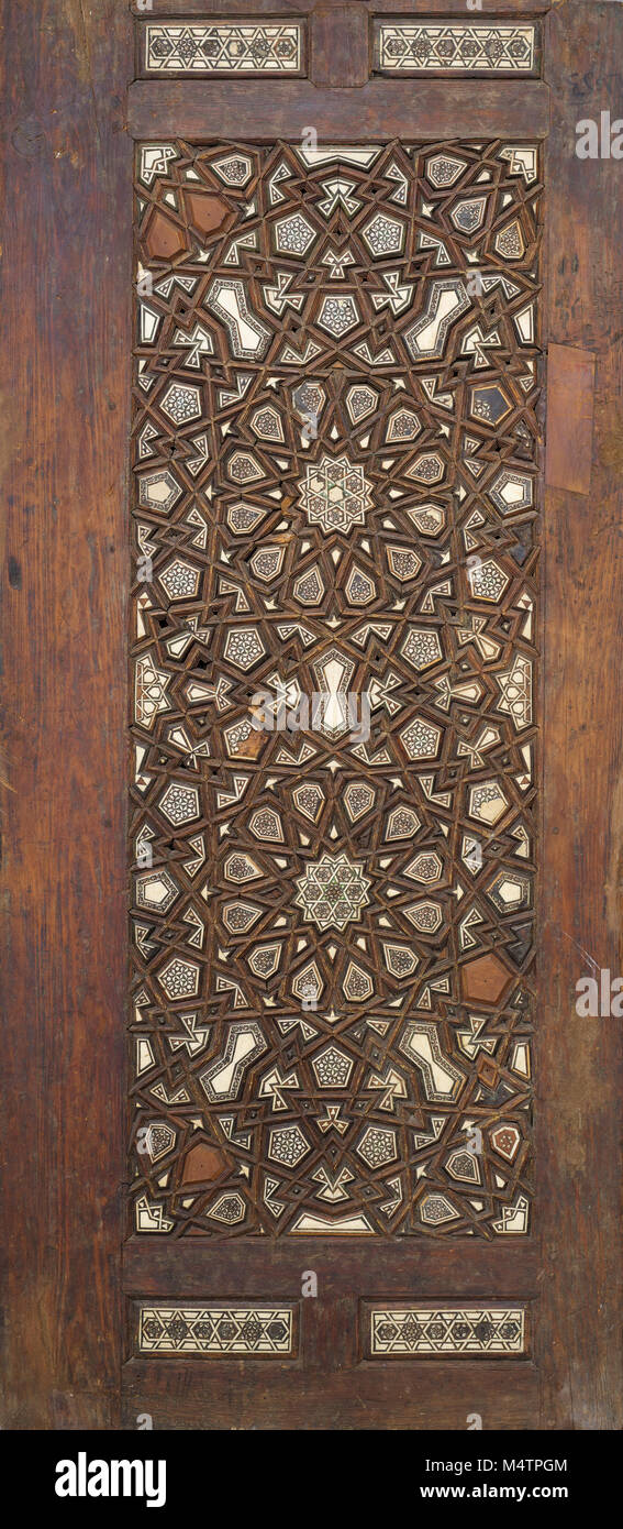 Ottoman style wooden ornate door leaf tongue and groove assembled inlaid with ivory, ebony and bone, Cairo, Egypt - Stock Image