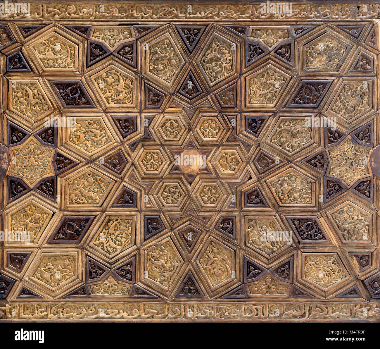 Ayyubid style panel with joined and carved wooden decorations of geometric and floral patterns, Mausoleum of Imam - Stock Image