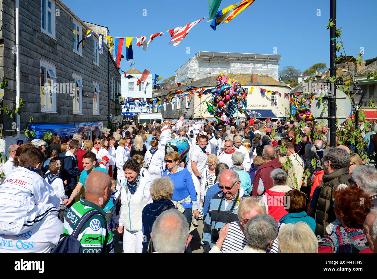 """the streets of padstow in cornwall, england, uk, are crowded with revellers during the annual may day """"obby oss"""" - Stock Image"""