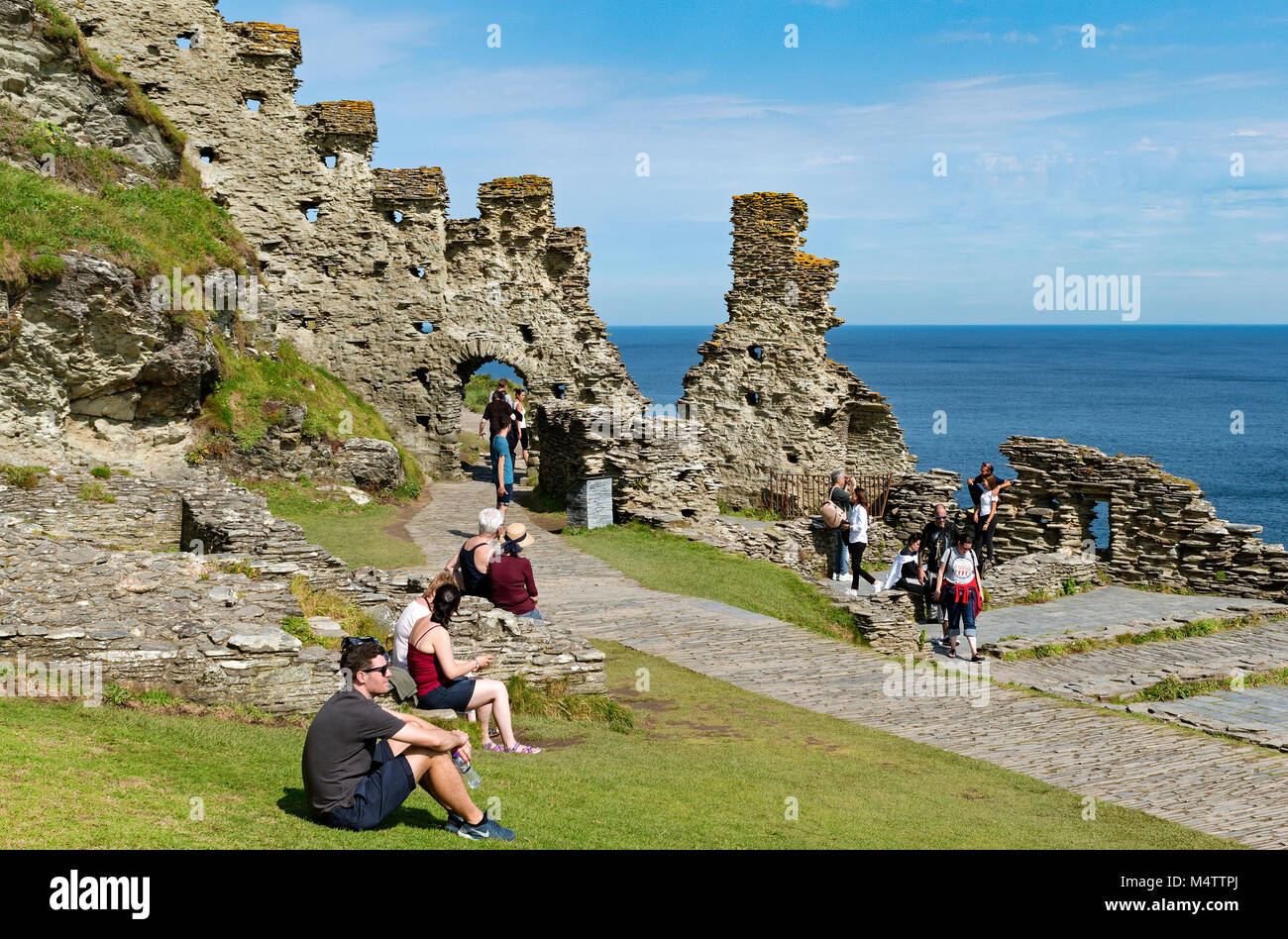 visitors at tintagel castle in north cornwall, england, britain, uk. - Stock Image
