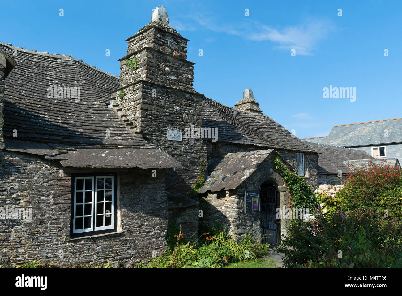 a medieval hall house now the old post office at tintagel, cornwall, england, britain, uk. this image was taken - Stock Image