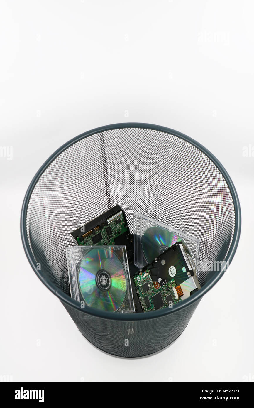 A waste basket of used disks and cds - Stock Image