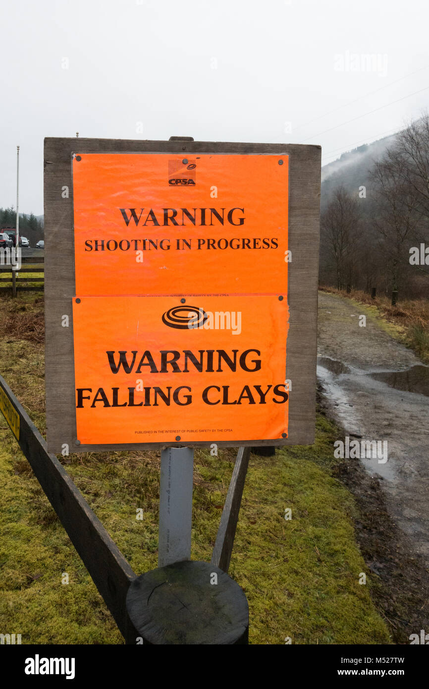 CPSA Warning shooting in progress warning falling clays sign next to Arrochar gun club, Scotland, UK - Stock Image