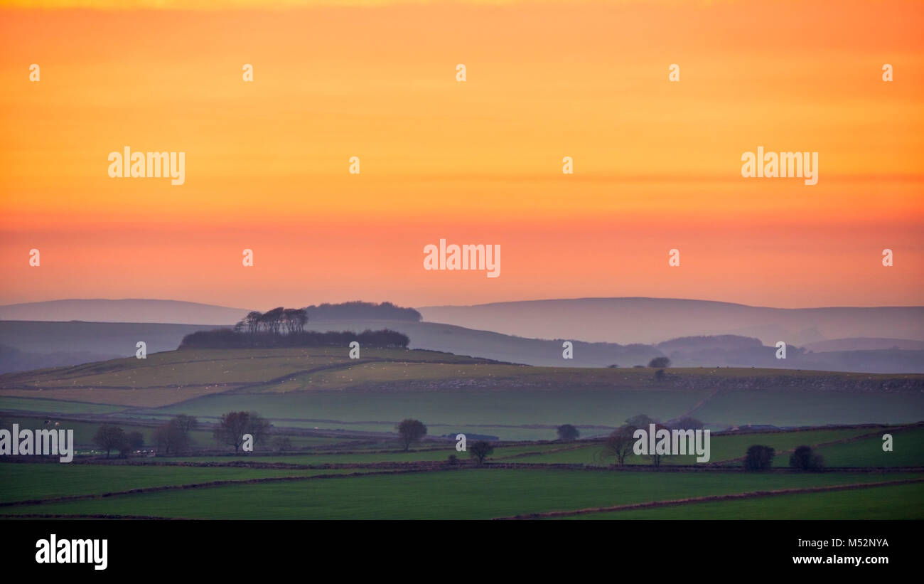 Sunset over Brassington viewed from Harborough Rocks, Peak District, Derbyshire, UK - Stock Image