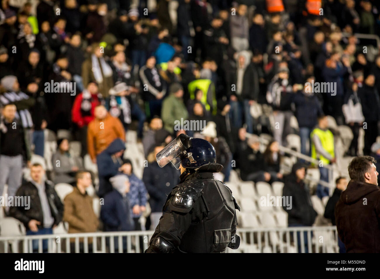 The police at the stadium event secure a safe match against the hooligans - Stock Image