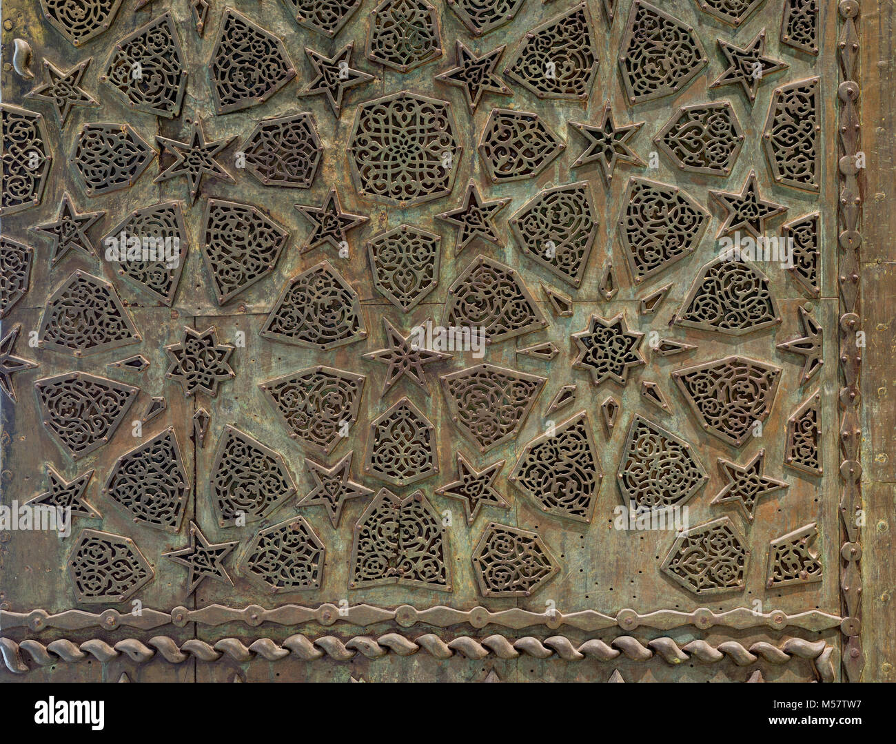Bronze-plate ornaments of an aged door, Cairo, Egypt - Stock Image