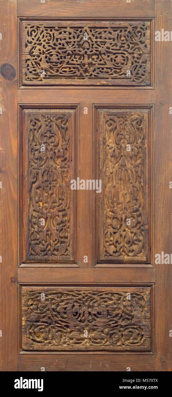 Arabesque floral engraved patterns of Fatimid style wooden ornate door leaf, Cairo, Egypt - Stock Image