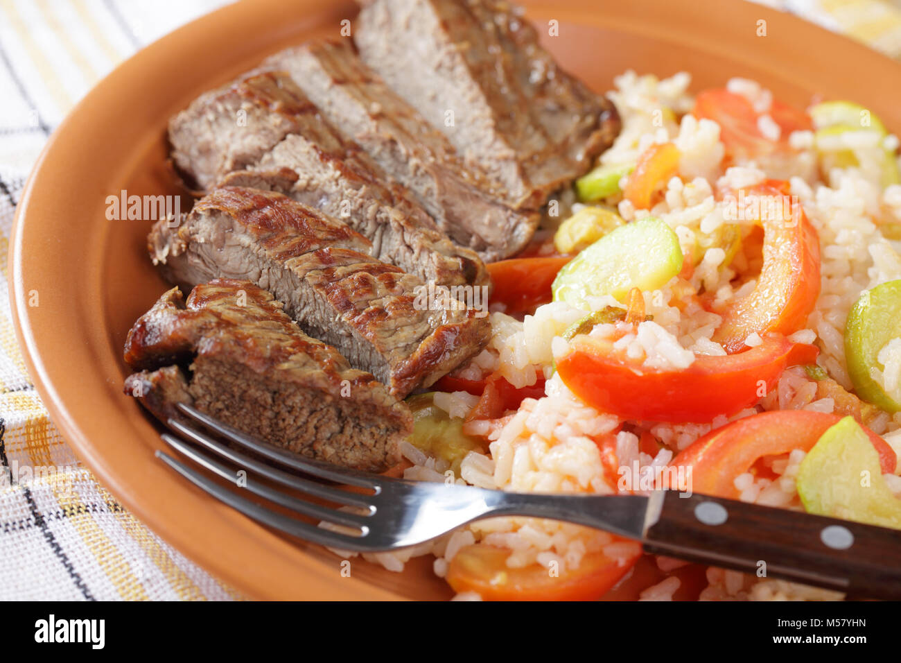 Sliced beef steak with rice and vegetables - Stock Image