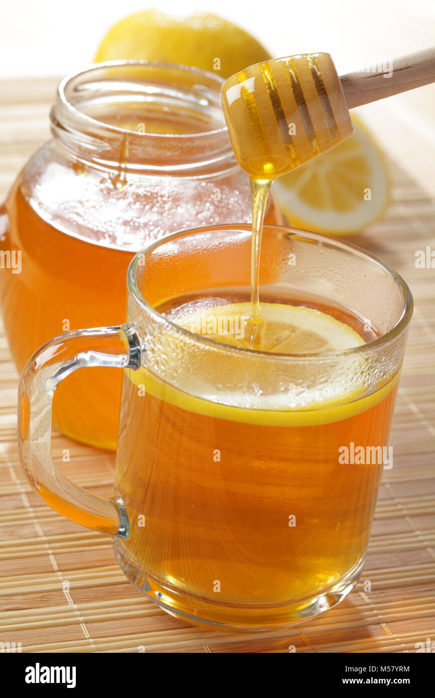Cup of tea with lemon and honey - Stock Image