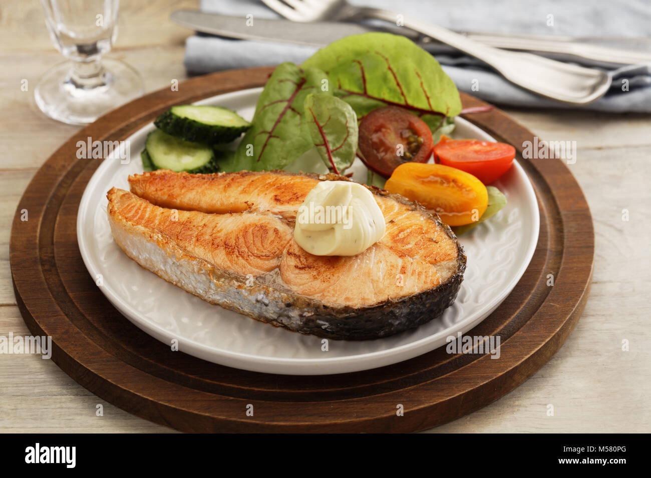 Roasted salmon steak with vegetables - Stock Image