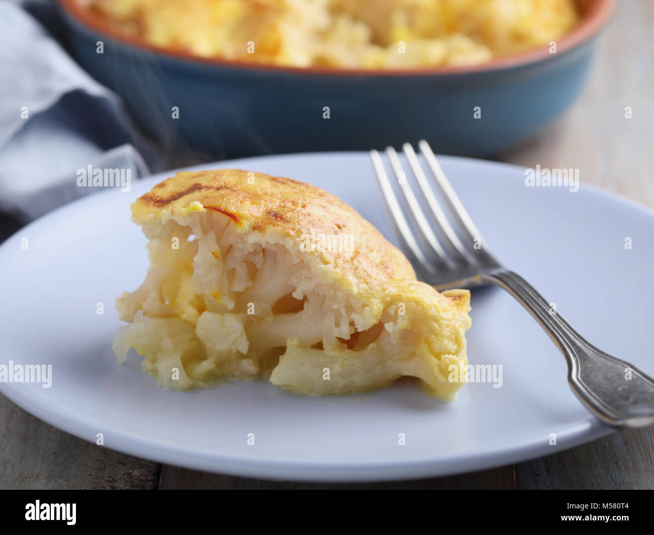 Portion of cauliflower cheese with saffron - Stock Image