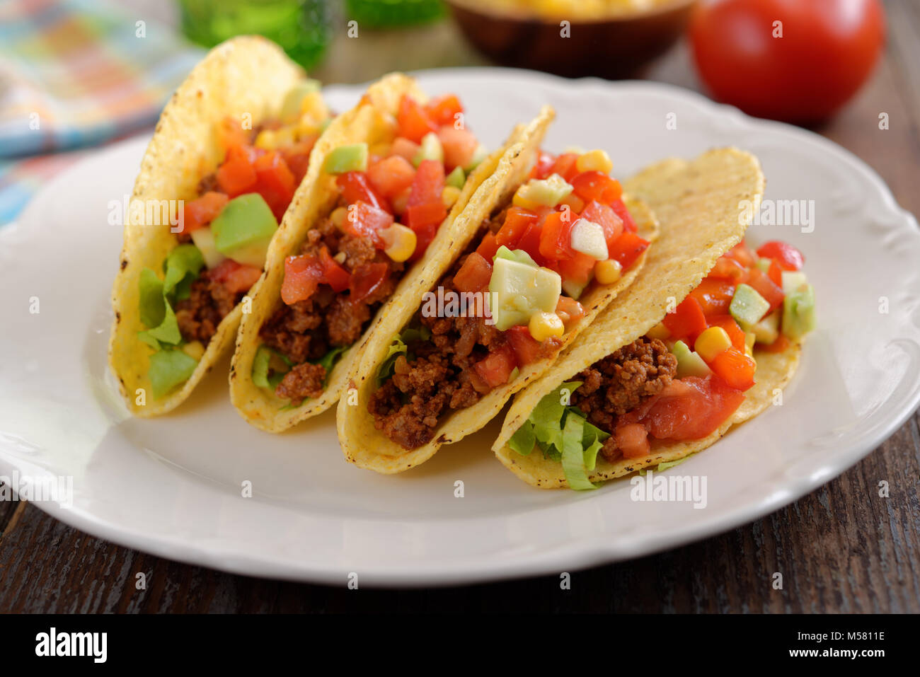 Tacos with ground beef and vegetables - Stock Image