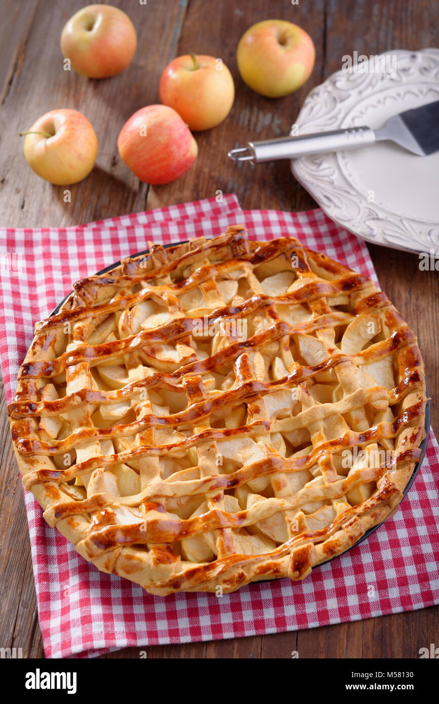 Apple pie on a rustic table - Stock Image