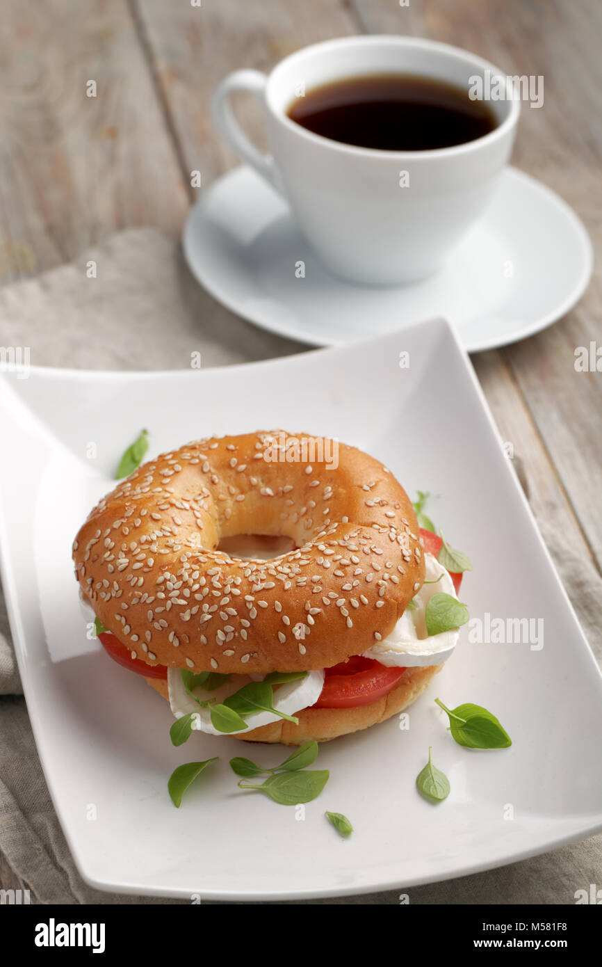 Bagel sandwich with goat cheese and vegetables - Stock Image