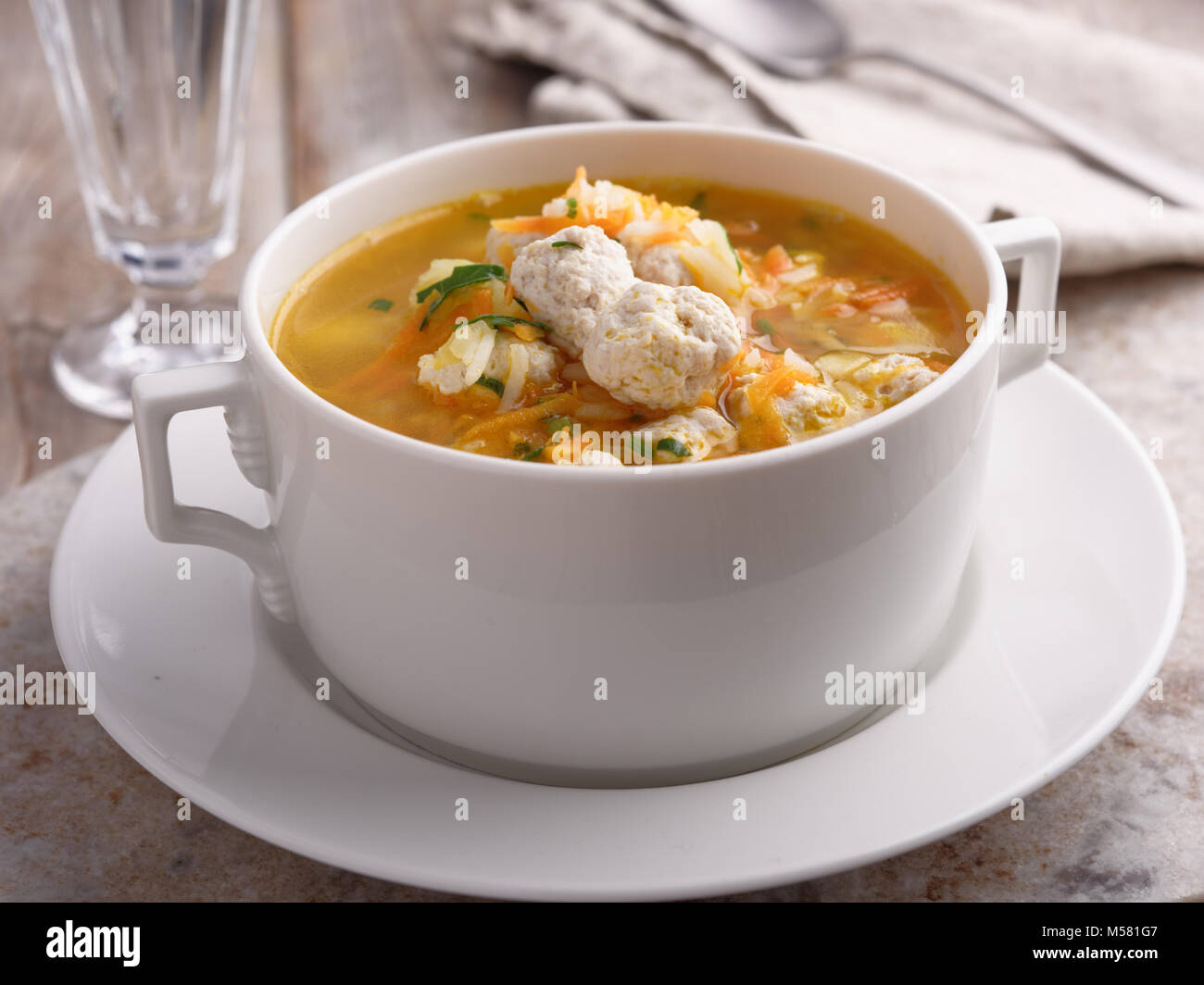 Chicken meatball soup with vegetables - Stock Image
