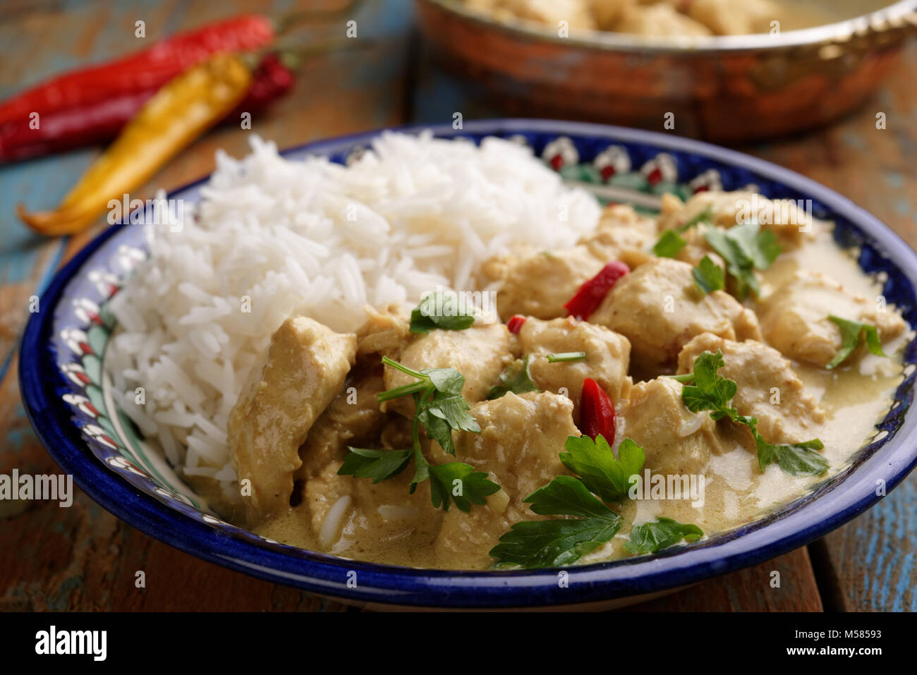Chicken curry with rice in an ornate plate - Stock Image
