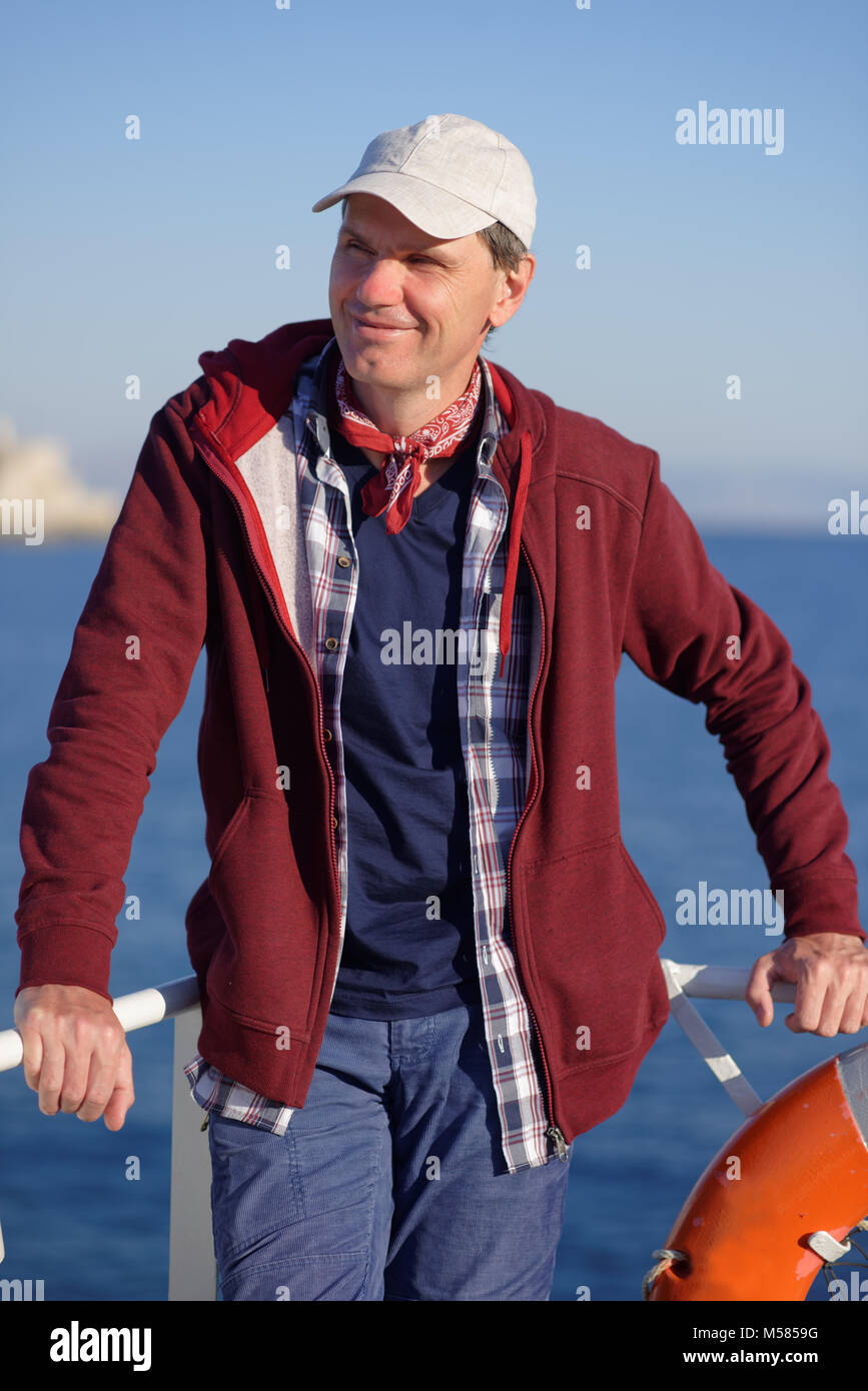 Tourist on a deck of tour boat - Stock Image