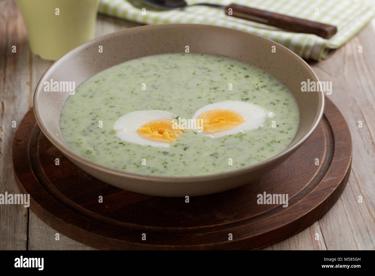 Spinach cream soup with boiled egg - Stock Image