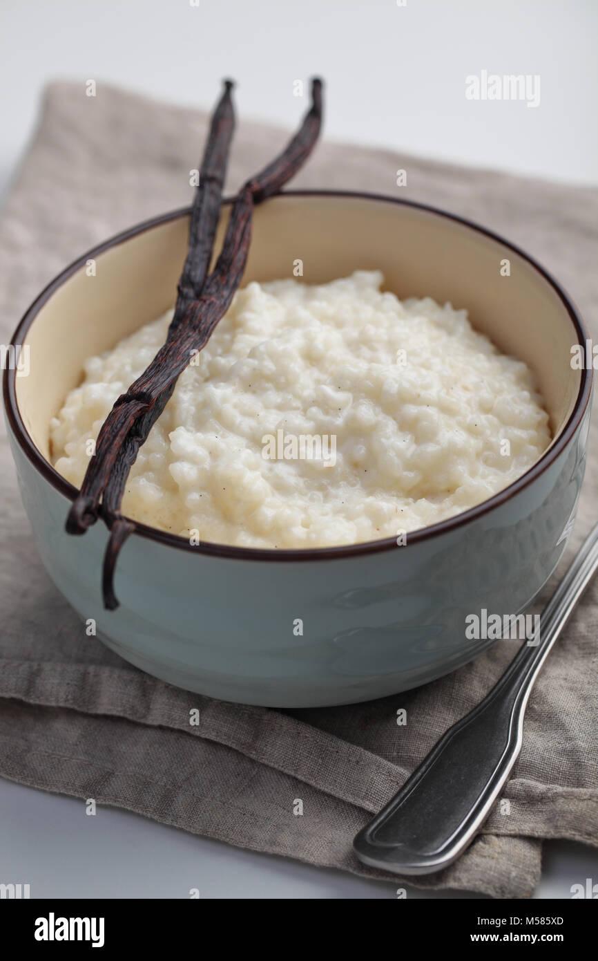 Rice pudding and vanilla sticks - Stock Image