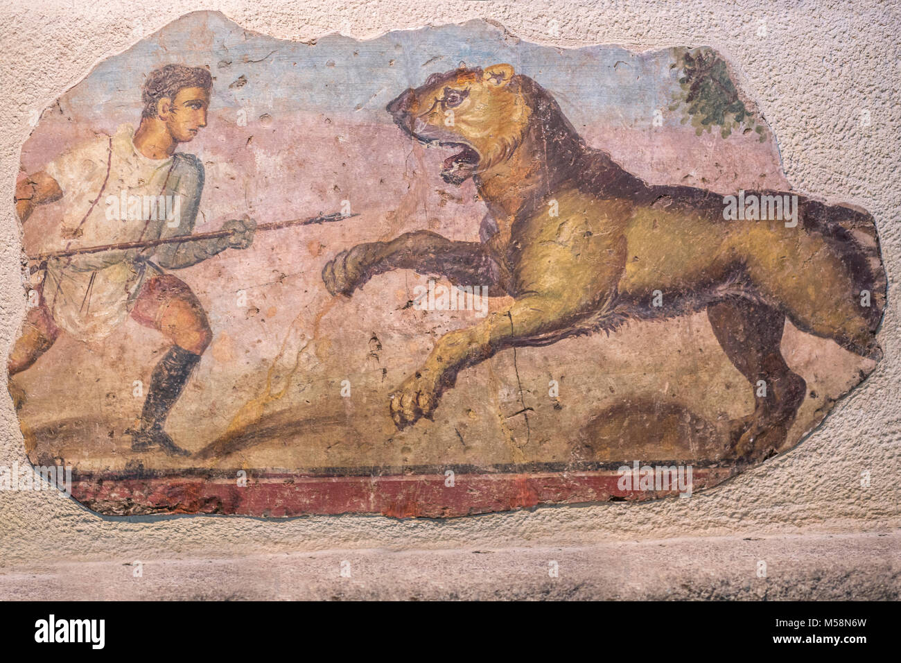 Merida, Spain - December 20th, 2017: Hunter with lioness painting at National Museum of Roman Art in Merida, Spain - Stock Image