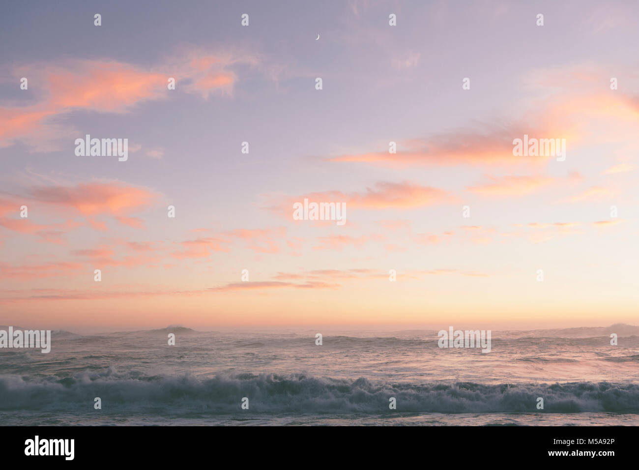 Seascape with cloudy sky at sunset. - Stock Image