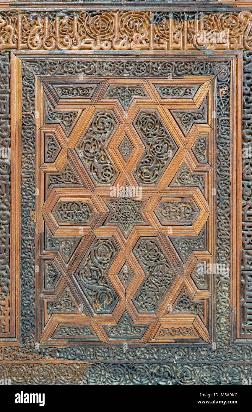 Arabesque floral engraved patterns of wooden ornate door leaf, Cairo, Egypt - Stock Image