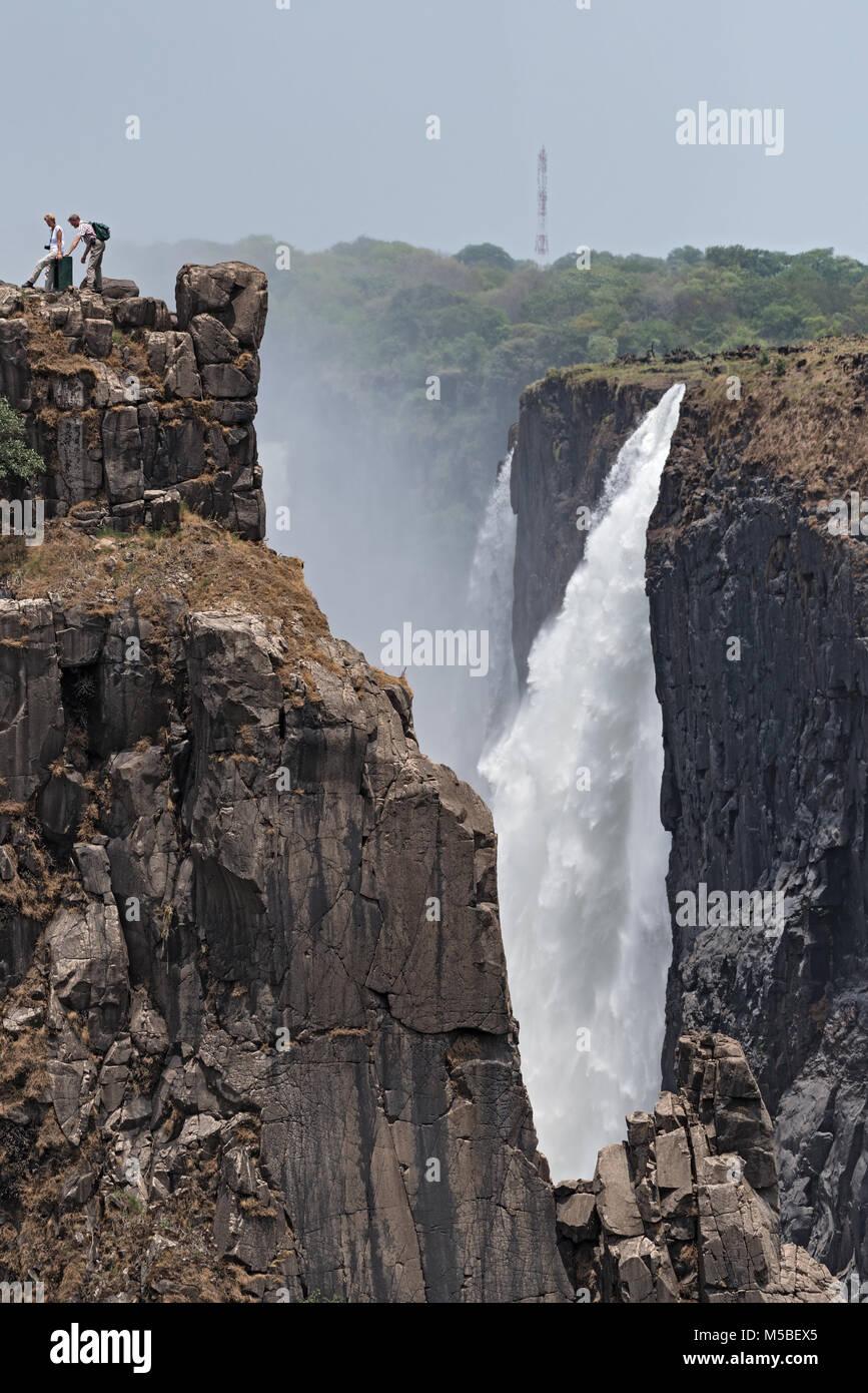 Tourists at the Victoria Falls, Zimbabwe, Zambia, Africa - Stock Image