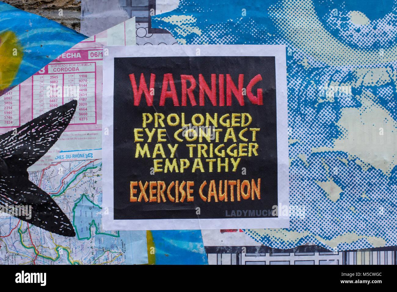 LONDON, UK - FEBRUARY 11, 2018: Graffiti, posters and stickers on Brick Lane, Banglatown, Spitalfields / Whitechapel. - Stock Image